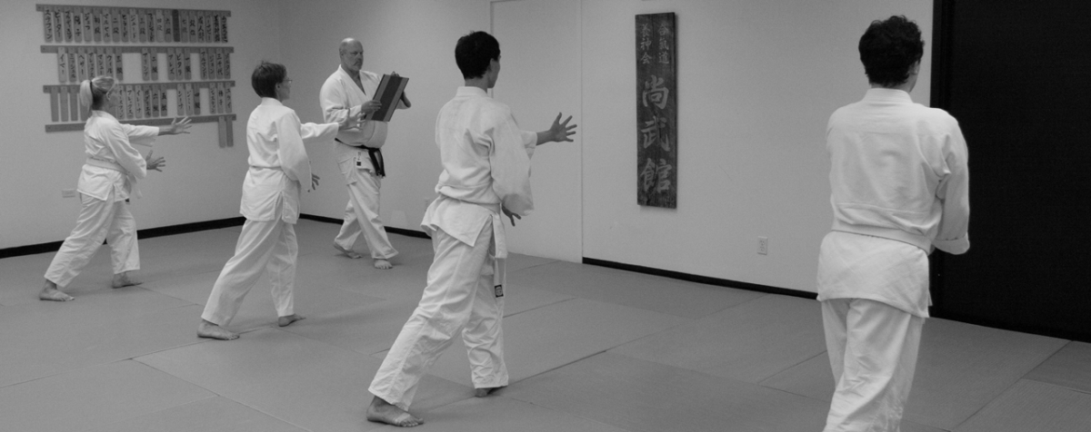 Photo of Mustard Shihan overseeing a kyu grading at one of the Shobukai dojos